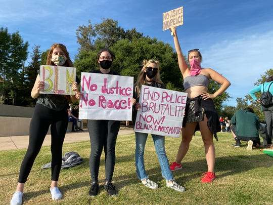 Friends Ashley Forster, left, Allie Yannetti, Joey Yannetti and Serena Foster attended the protest over George Floyd's death in Thousand Oaks on May 31, 2020.