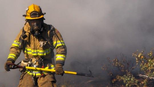 A firefighter battles a blaze on Santa Cruz Island Sunday.