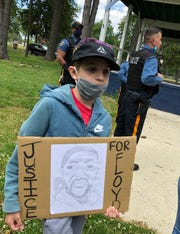 Jaiden Santiago, 12, of Vineland, carried his sketch of George Floyd during a peaceful protest June 1 in Vineland.