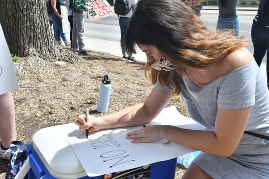 """Protesters peacefully gathered outside the Tulare County Superior Court Monday morning to call for the prosecution of occupants of a Jeep that struck two Visalia activists during a Saturday demonstration.  Visalia Police Department chided both sides of the conflict, saying the driver """"acted irresponsibly"""" but no arrests will be made."""