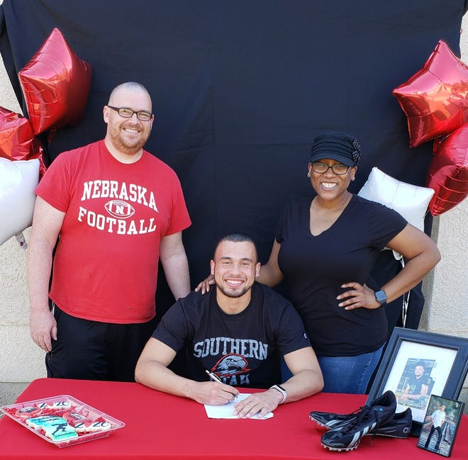 El Diamante High School senior Cameron Beans poses for a photo with his father, Andrew, and mother, Tracy, in April. Beans will run track in college at Southern Utah, an NCAA Division I program.