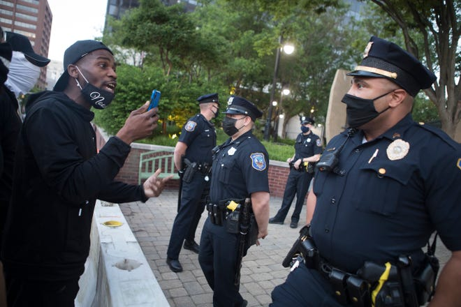 Protestors held a gathering for discussion with local leaders and police in response to the death of George Floyd Sunday, May 31, 2020, outside of the Louis L. Redding City/Council Building in Wilmington.