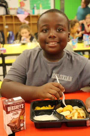 Elijah Patterson enjoys a nutritious Kids Cafe meal, made available through the Wichita Falls Area Food Bank. Free meal distribution sites will provide a free meal to anyone under age 18.