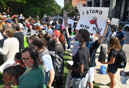 Hundreds of people participated in a peaceful protest against racial injustice Monday afternoon in downtown Wichita Falls.