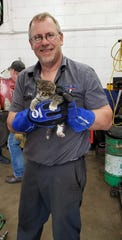 Pete Renkas and rescued kitten.