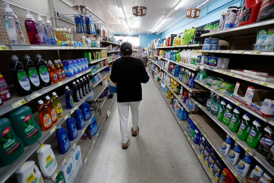 A shopper walks down an isle at a local super market, Friday, May 29, 2020, in Des Moines, Iowa.
