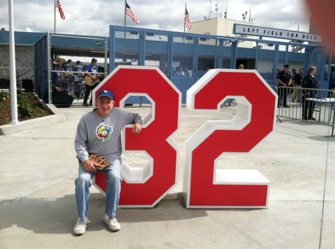 Ross Miller at the No. 32 statue honoring Sandy Koufax at Dodger Stadium.