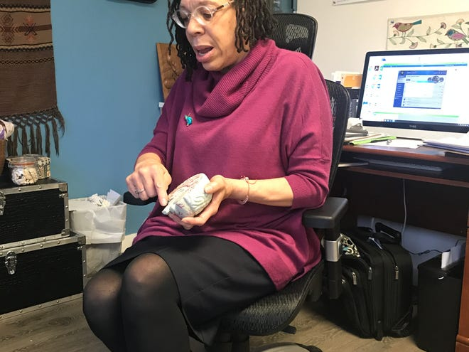 Dr. Terry Jarrett, a Washington psychiatrist, points out parts of a model brain  in her office in February 2019.