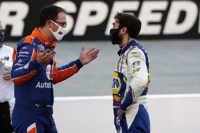 Driver Joey Logano, left, and driver Chase Elliott talk after the during the NASCAR Cup Series at Bristol Motor Speedway in Bristol, Tenn. on May 31, 2020.