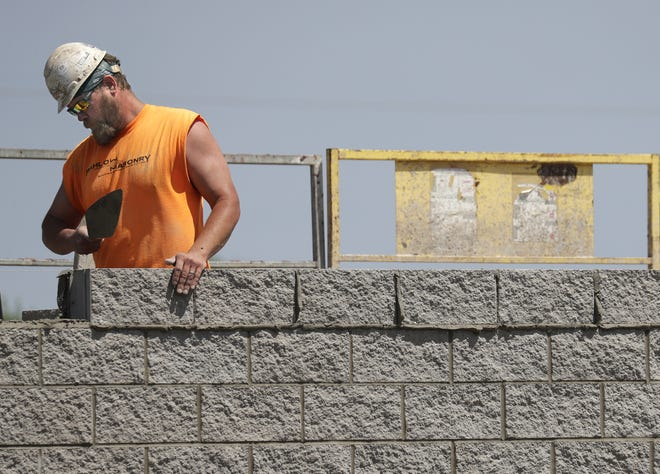 Masonry work is done on the new AutoZone on Integrity Way near N. McCarthy Road in Grand Chute.
