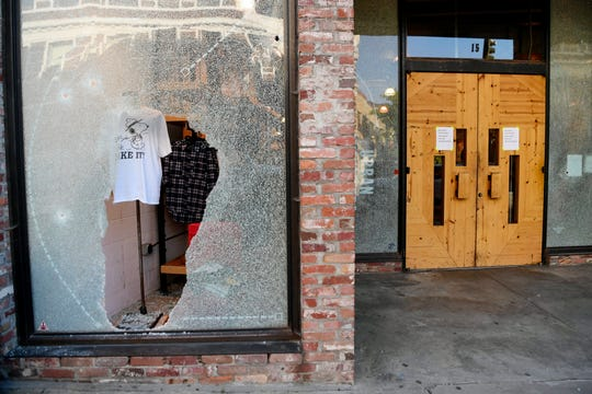 Windows at Urban Outfitters were shattered by bullet holes  in downtown Asheville.