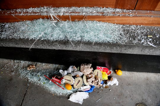 Glass and a pile of garbage below a broken window at Collaboratory on N Lexington Ave in downtown Asheville June 2, 2020.
