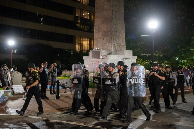 A second night of protesting in downtown Asheville in response to the killing of George Floyd, who is black, by a white police officer in Minneapolis ended with tear gas, graffiti and some property damage on June 1, 2020.