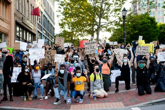 Hundreds gathered at Vance Monument in downtown Asheville June 1, 2020 to protest police brutality before continuing on to Asheville Police Department.