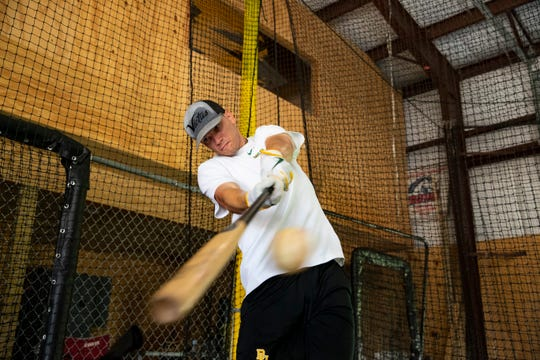 Ray High School graduate and Baylor baseball player Nick Loftin hits a ball as he practices at Cage Nation on June 2, 2020.