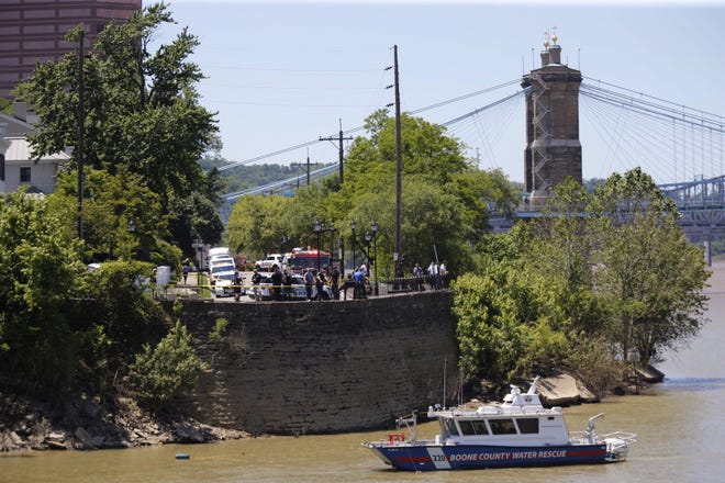 Rescue crews try to locate a van that went off the road and into the Ohio River on Tuesday, June 2, 2020.