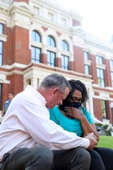Montgomery County Mayor Jim Durrett holds hands and comforts Hellena Washington on the outskirts of the protest after hearing Washington out at a protest for justice over the death of George Floyd at the Montgomery County Historic Courthouse in Clarksville, Tenn., on Tuesday, June 2, 2020. Washington, a military veteran, made a point that she offered her life for her country in service, and that the cause she showed up for at the protest held the same weight.