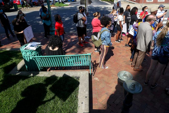 Residents gather around a center circle to listen to speakers at a protest for justice over the death of George Floyd at the Montgomery County Historic Courthouse in Clarksville, Tenn., on Tuesday, June 2, 2020.