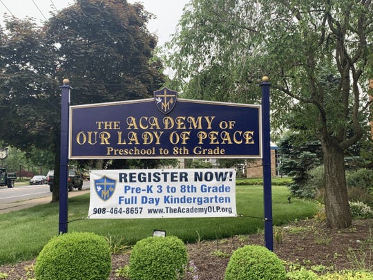 The sign for The Academy of Our Lady of Peace School in New Providence