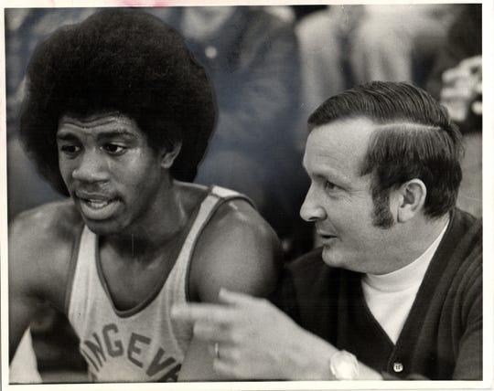 "Former Lansing Everett coach George Fox with Earvin ""Magic"" Johnson."