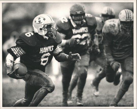 Farmington Hills Harrison quarterback Mill Coleman.
