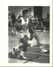 Plymouth Salem's basketball player Dena Head