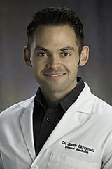 Dr. Justin Skrzynski, an internal medicine physician at Beaumont Hospital in Royal Oak.
