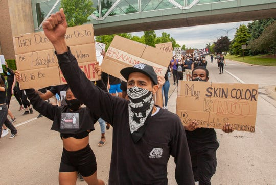 Protesters in Troy on Monday.