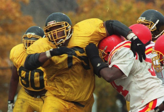 Detroit King's Anthony Adams rushes the passer during a game at Detroit King on Nov. 4, 1997.