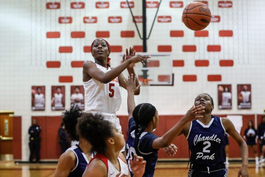 Detroit Edison's Rickea Jackson (5) makes a pass against Chandler Park during the second half of the district semifinal at Harper Woods High School in Harper Woods,  Wednesday, March 6, 2019.