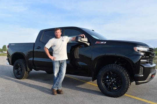 UAW Local 2209 Shop Chairman Rich LeTourneau stands next to a 2020 Chevrolet Trail Boss Silverado pickup built on June 2, 2020. It was recently at GM's Fort Wayne Assembly plant.