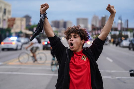 Stefan Perez of Detroit halts protesters during a march he helped lead through Detroit on Monday, June 1, 2020.