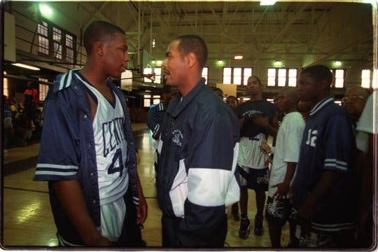 Detroit Central's Antonio Gates talks with coach Orando Taliaferro before their prep boys basketball game against King at Central High School in Detroit. Gates, a 6-4 senior is one of the best players in the state. (Tue. 12/16/97 photo by William Archie/Detroit Free Press)