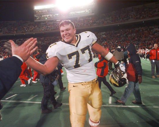 Former Clawson High School star Jon Jansen, who helped Michigan win a national championship in 1997.