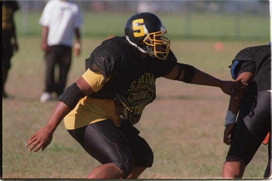 Saginaw High School's LaMarr Woodley at practice, Tuesday, Aug. 20, 2002, in Saginaw.  Woodley went to Michigan and later became a star in the NFL.