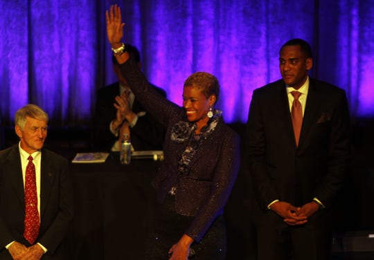 Pam McGee waves with fellow inductees Dick Kimball, left, and Steve Smith during the Michigan Sports Hall of Fame ceremony at Fisher Music Center in Detroit, on Monday, Feb. 18, 2013.