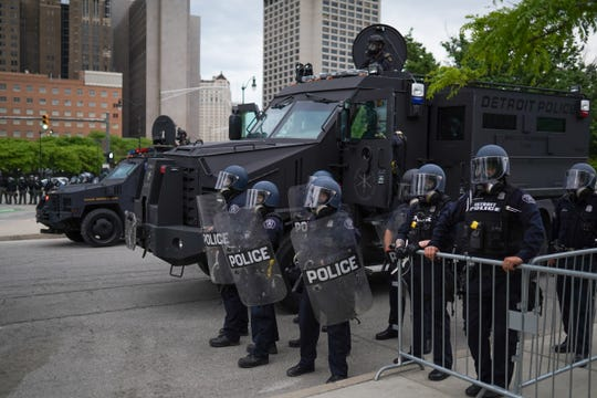 Detroit Police officers line Michigan Ave. while awaiting protestors returning from a march through Detroit on Monday, June 1, 2020
