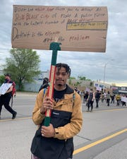 Kevon Garaway, 23, Detroit, marches in a protest against police brutality Monday, June 1, in Detroit.