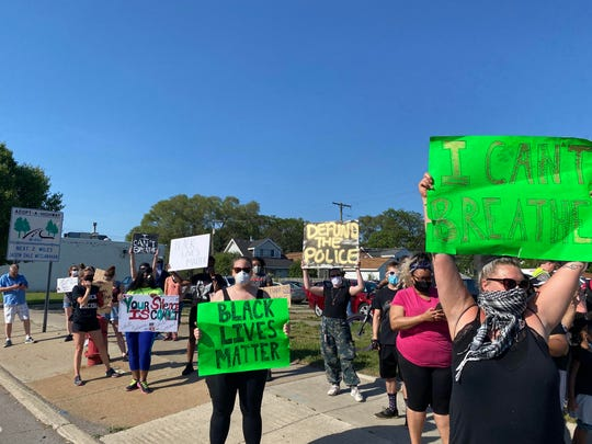 Protesters stand on the side of Van Dyke Ave. during the event on Tuesday, June 2, 2020 in Warren. (Emma Dale, Detroit Free Press)