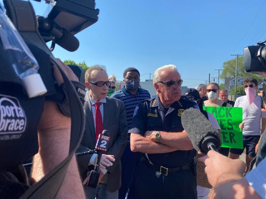 Mayor James Fouts (left) and Officer Bill Dwyer (right) talk to media and protesters during the event on Tuesday, June 2, 2020 in Warren. (Emma Dale, Detroit Free Press)