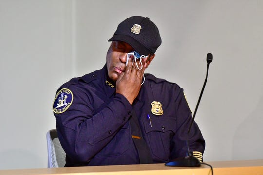 Detroit deputy chief of police Todd Bettison wipes tears from his eyes with his mask after speaking at a press conference at Detroit Police Safety Headquarters, Tuesday. Bettison became emotional after speaking about kneeling with protesters during Sunday evening's protest. (Photo: David Guralnick, The Detroit News)