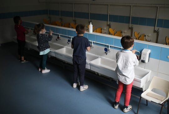 In this May 14, 2020 file photo, children wash their hands at the Saint-Tronc Castelroc primary school in Marseille, southern France.