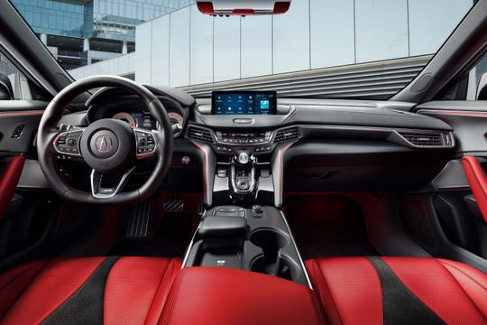 The interior of the 2021 Acura TLX will come with a dash-mounted tablet screen, touch-pad controller, and 16-way leather seats.