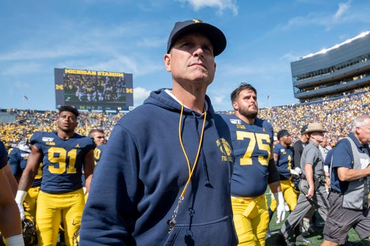 Michigan head coach Jim Harbaugh joined some of his coaches and a handful of players in a protest march Tuesday through the streets of Ann Arbor.