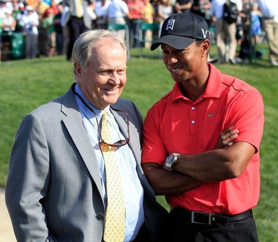 Jack Nicklaus and Tiger Woods chat at the Memorial tournament in 2012.