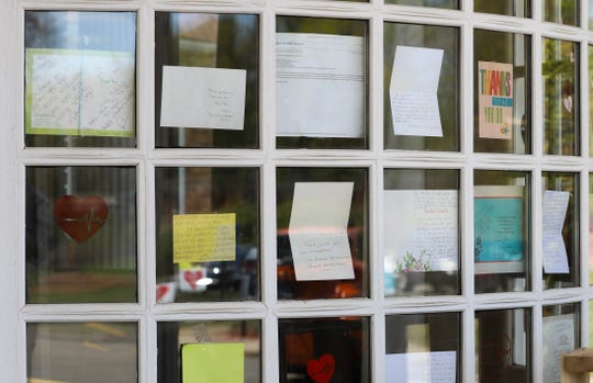 """Notes for healthcare workers hang in the front window at the Kimberly Hall North nursing home, Thursday, in Windsor, Conn. The coronavirus has had no regard for health care quality or ratings as it has swept through nursing homes around the world, killing efficiently even in highly-rated care centers. Preliminary research indicates the numbers of nursing home residents testing positive for the coronavirus and dying from COVID-19 are linked to location and population density"""" not care quality ratings."""