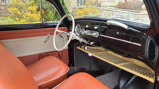The dash of the 1964 VW Bug is a simple affair with one gauge for speed, a radio, and a four speed manual shifter on the floor. Controls were limited to windshield wipers.