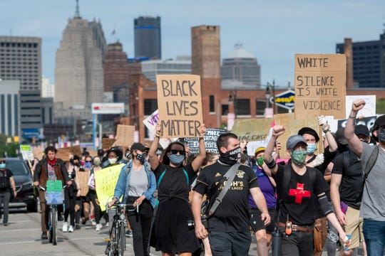 Protesters march down Michigan Avenue in Detroit, June 1, 2020, to protest against the death of George Floyd.
