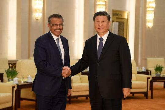 In this Jan. 28, 2020, file photo, Tedros Adhanom Ghebreyesus, director general of the World Health Organization, left, shakes hands with Chinese President Xi Jinping before a meeting at the Great Hall of the People in Beijing.