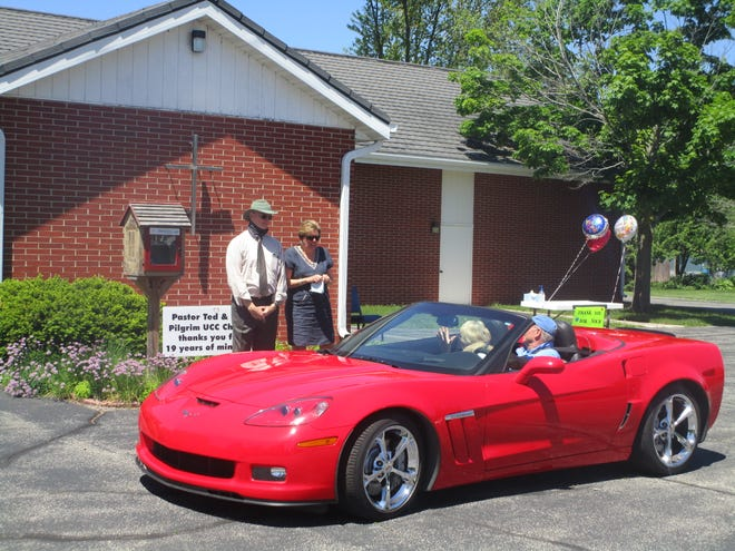 Pastor Ted Drewsen and his wife, Deb, say goodbye to Pilgrim United Church of Christ parishioners on Sunday, May 31, 2020 during a car parade in honor his retirement after 19 years of service.